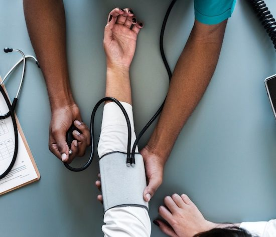 Wellbeing Tips for National Mental Health Awareness Month person getting their blood pressure checked