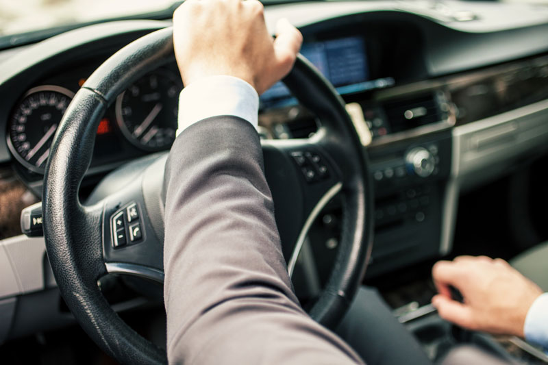 a business man driving a car | What's the Difference Between Personal and Commercial Auto Insurance?