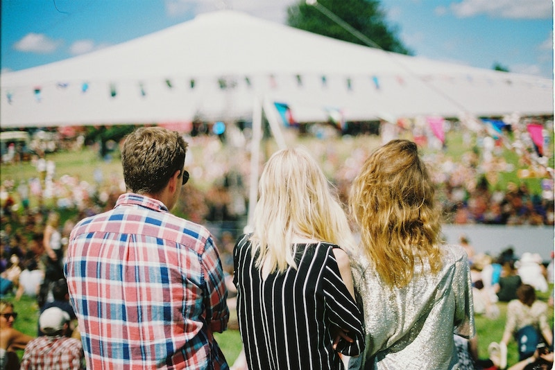 three people at a festival