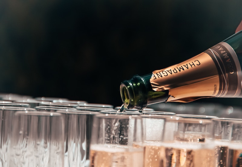 topping up champagne glasses