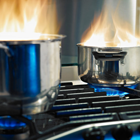 two pans on a stove