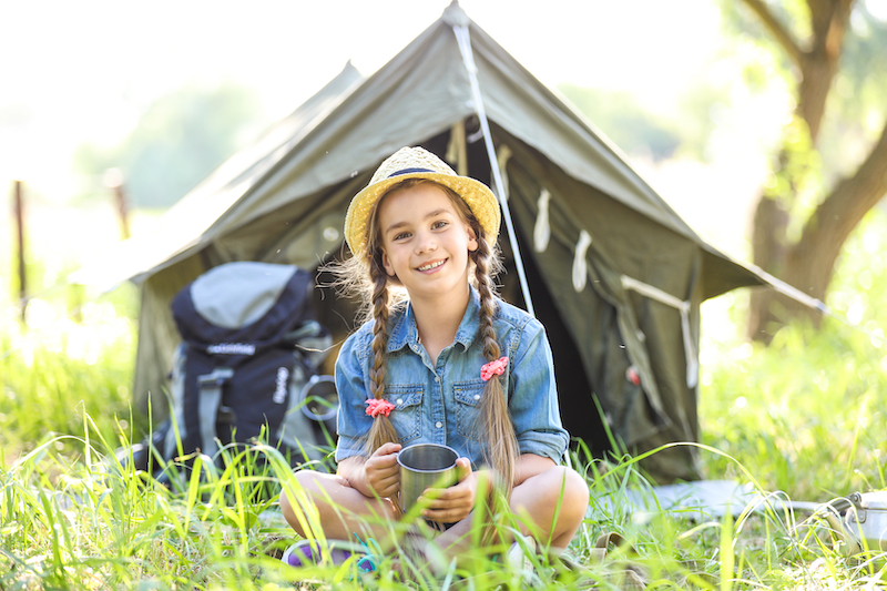 a child in a tent